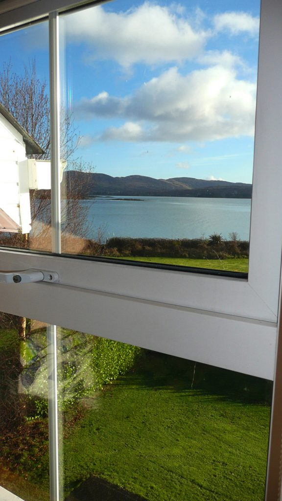 Heron Water Cottage, Bedroom Window. Rent an Irish Holiday Home with Sea View along the Wild Atlantic Way in Kerry, Rent a Cottage with Seaview in Ireland along the Ring of Kerry.