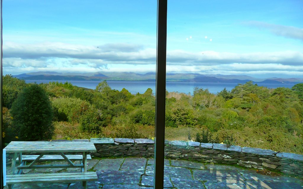Yvonnes, the Dining Room or Living Room View. Even with the clouds low, it is spectacular. Rent an Irish Cottage with Sea View along the Wild Atlantic Way in Kerry from www.fir-darrig.net. Rent a Holiday Home with Seaview in Ireland along the Ring of Kerry.