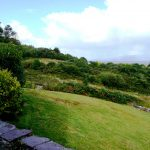 Yvonnes, the Patio overlooking the Garden. Rent an Irish Cottage with Sea View along the Wild Atlantic Way in Kerry from www.fir-darrig.net. Rent a Holiday Home with Seaview in Ireland along the Ring of Kerry.