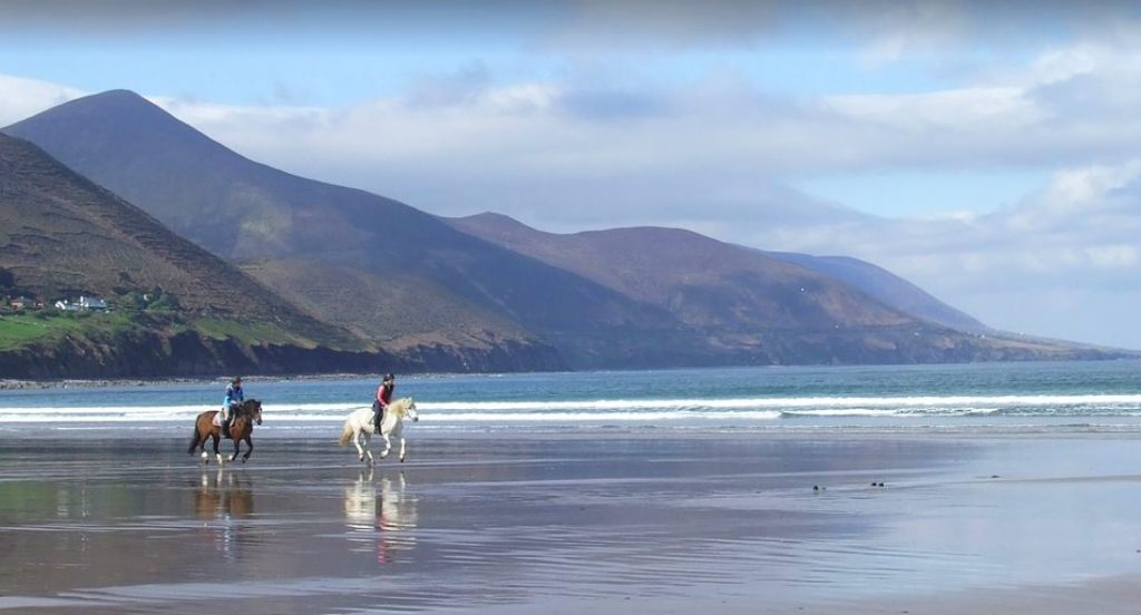 Horse Riding at Rossbeigh Beach near Holiday Home Castle View in Glenbeigh, County Kerry, Ireland.