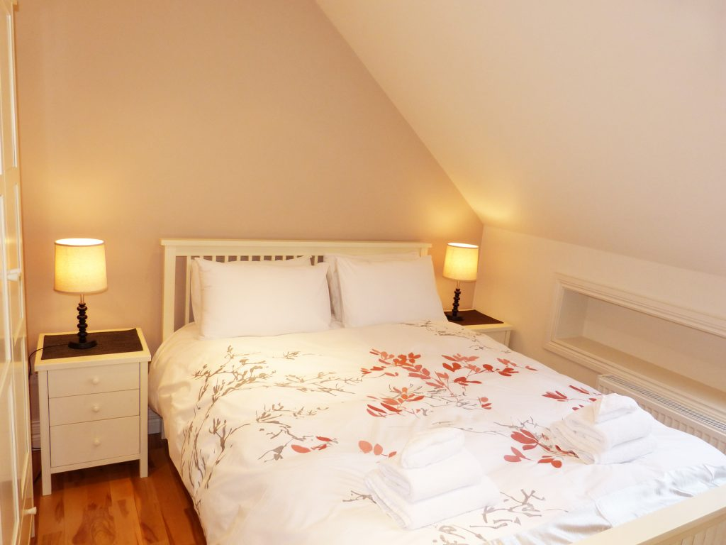 Bedroom 6 has one Double Bed on the first Floor of Holiday Home Castle View in Glenbeigh, County Kerry, Ireland.