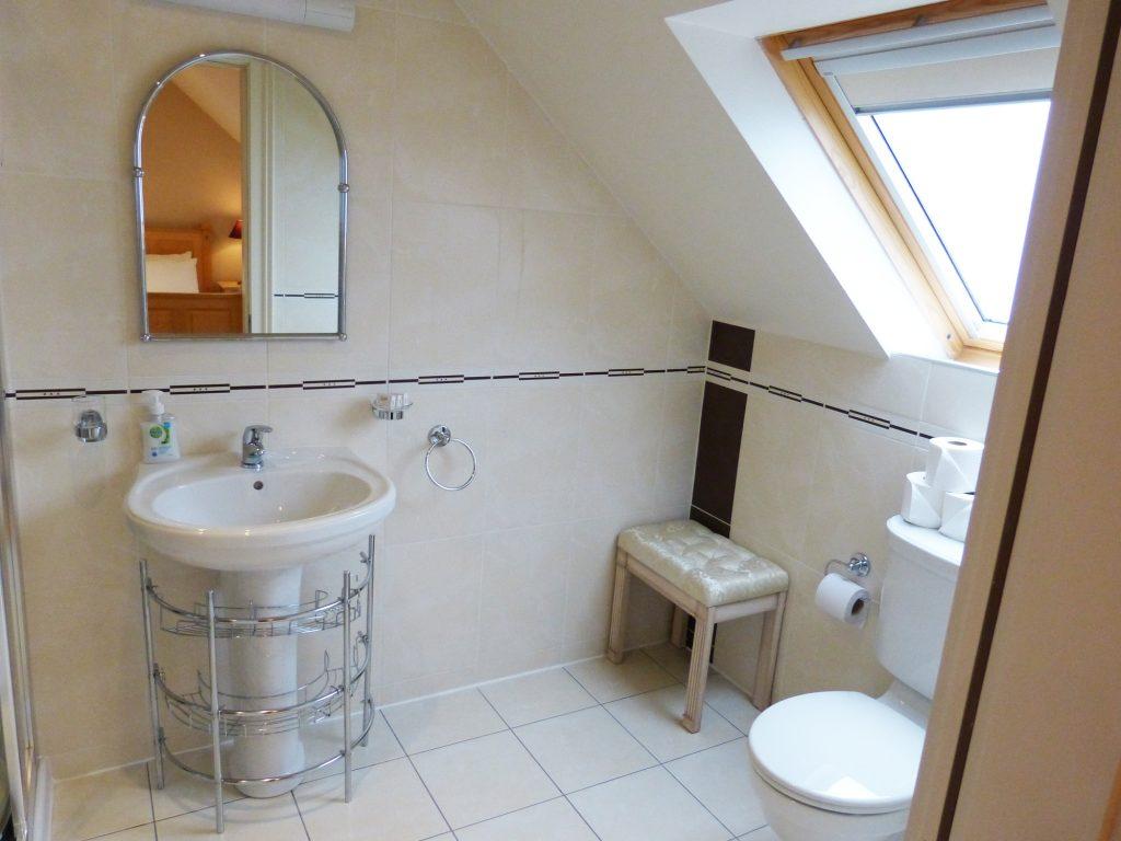 Bath Room to Bedroom four and five on the first Floor of Holiday Home Castle View in Glenbeigh, County Kerry, Ireland.
