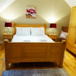 Bedroom 7 has one Double Bed on the first Floor of Holiday Home Castle View in Glenbeigh, County Kerry, Ireland.